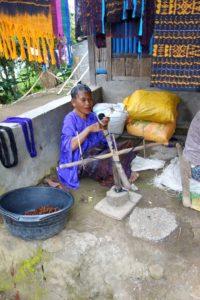 woman weaving ikat, moni, flores, indonesia